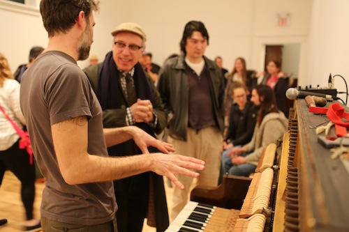 Wedman talking to artist Frank Bull at the performance
